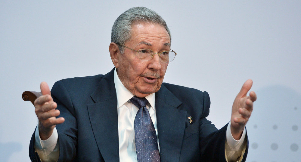 Cuba's President Raul Castro speaks with US President Barack Obama (out of frame) on the sidelines of the Summit of the Americas at the ATLAPA Convention center on April 11, 2015 in Panama City