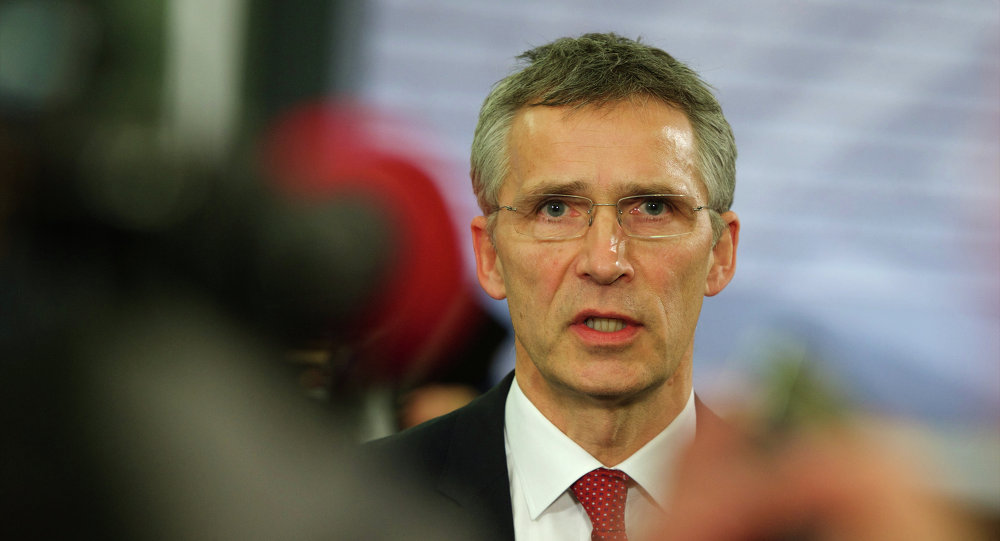 NATO Secretary General Jens Stoltenberg speaks with journalists prior to an Informal Meeting of EU Defence Ministers in Riga, Latvia on January 18, 2015