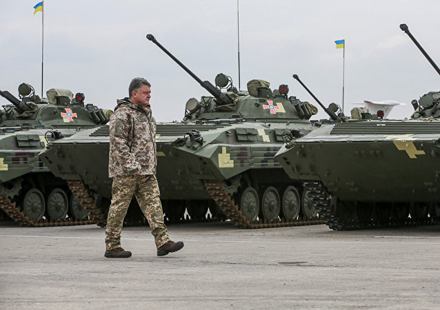 Ukrainian President Petro Poroshenko attends a ceremony to hand over weapons and military vehicles to servicemen of the Ukrainian armed forces in Chuhuiv outside Kharkiv, Ukraine, October 15, 2016
