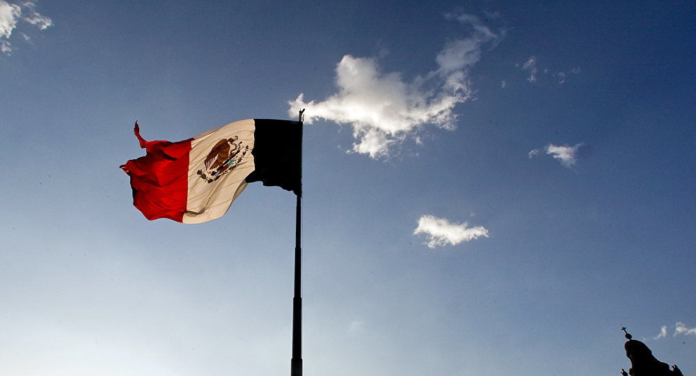 A Mexican flag flutters at the Zocalo square in Mexico City, on April 29, 2009. The World Health Organisation raised its flu alert to phase five out of six, WHO chief Margaret Chan said, signalling that a pandemic was imminent following the swine flu outbreak.