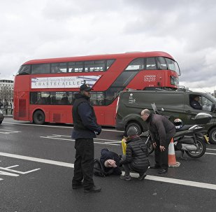 A man lies injured after a shootingt incident on Westminster Bridge in London
