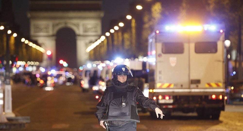 A police officer stands guard after a fatal shooting in which a police officer was killed along with an attacker on the Champs Elysees in Paris, France, Thursday, April 20, 2017.