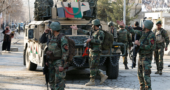 Afghan commando troops watch outside a military hospital in Kabul, Afghanistan March 8, 2017