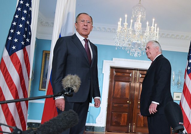 US Secretary of State Rex Tillerson (R) watches as Russian Foreign Minister Sergei Lavrov reacts to a reporter's question after posing for photos in the Treaty Room of the State Department in Washington, DC on May 10, 2017.