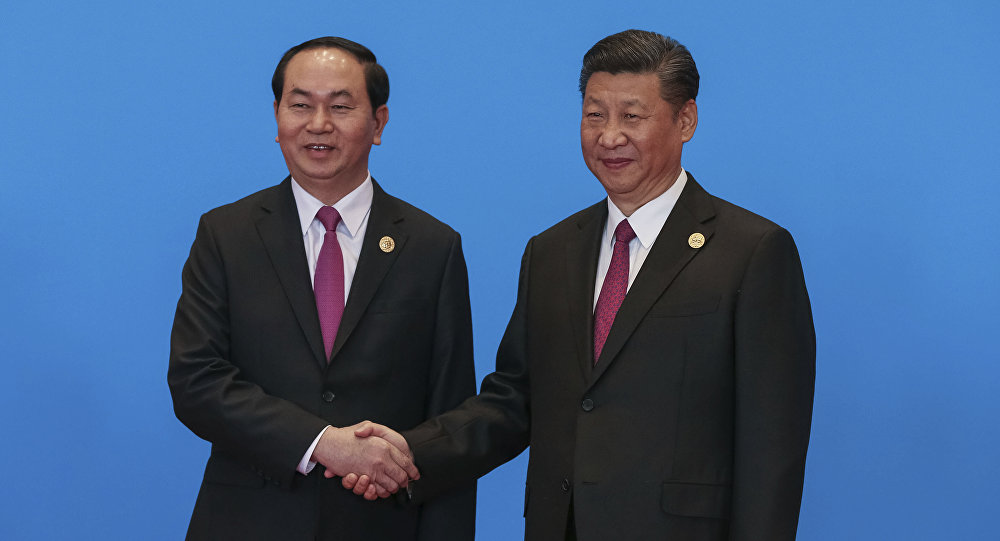 Chinese President Xi Jinping, right, shakes hands with Vietnamese President Tran Dai Quang during the welcome ceremony for the Belt and Road Forum