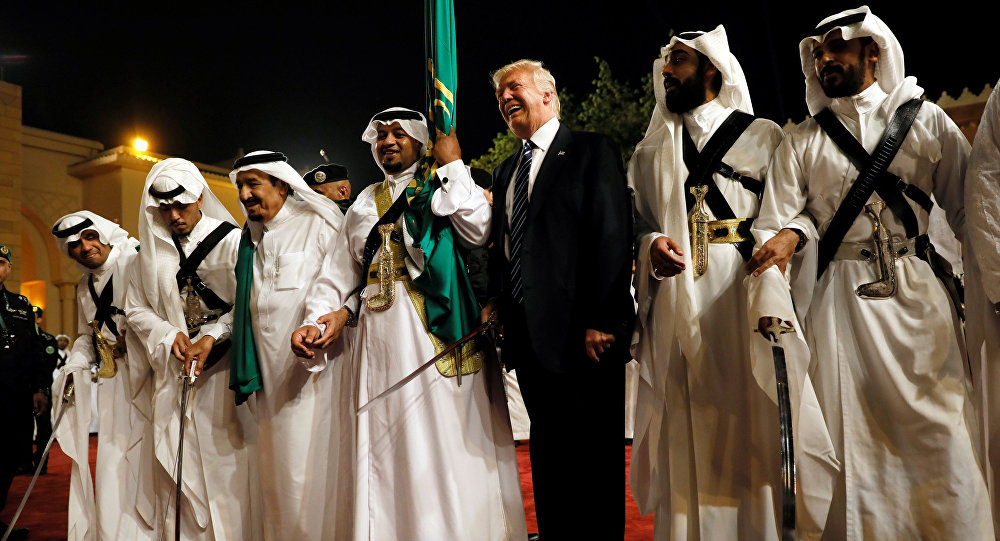 U.S. President Donald Trump dances with a sword as he arrives to a welcome ceremony at Al Murabba Palace in Riyadh, Saudi Arabia May 20, 2017