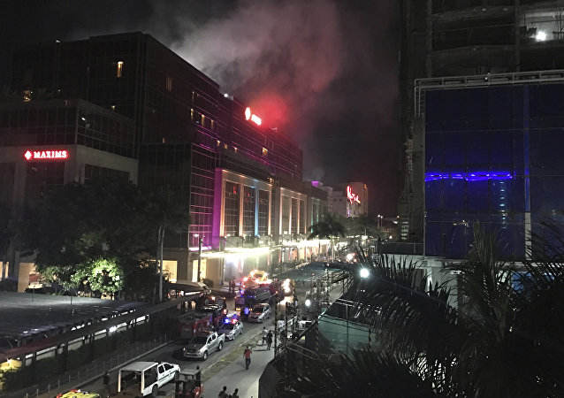 Smoke rises from the Resorts World Manila complex early Friday, June 2, 2017 in Manila, Philippines.