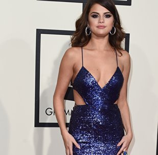 Singer Selena Gomez arrives on the red carpet during the 58th Annual Grammy Music Awards in Los Angeles February 15, 2016