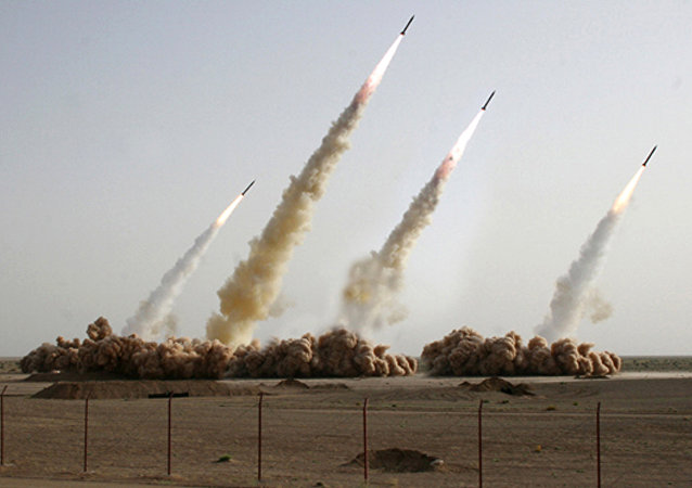 A handout picture released on the news website and public relations arm of Iran's Revolutionary Guards, Sepah News, shows an image apparently digitally altered to show four missiles rising into the air instead of three during a test-firing at an undisclosed location in the Iranian desert (File)