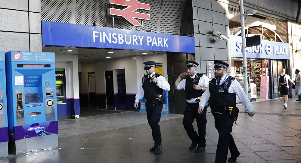 Police patrol outside Finsbury Park station in north London after a vehicle hit pedestrians, on June 19, 2017.