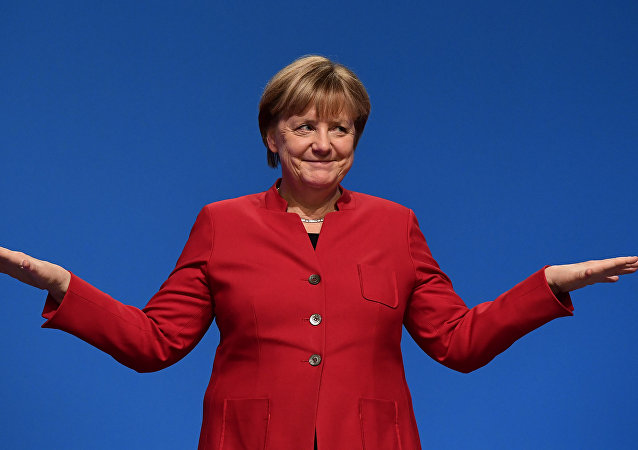 German Chancellor Angela Merkel gestures after addressing delegates during her conservative Christian Democratic Union (CDU) party's congress in Essen, western Germany, on December 6, 2016.