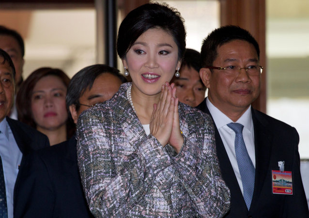 Thailand's former Prime Minister Yingluck Shinawatra arrives at parliament in Bangkok, Thailand Thursday, Jan. 22, 2015