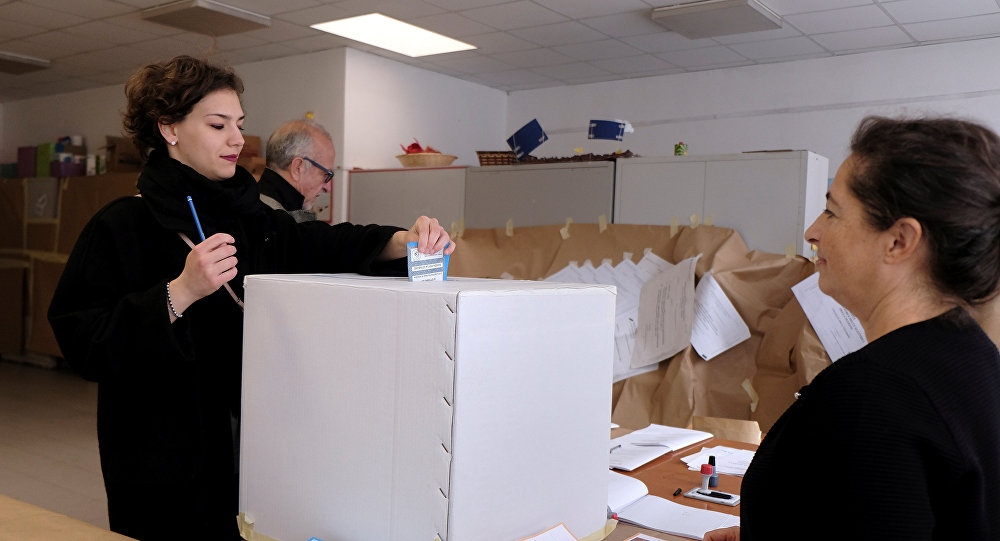 A woman casts her vote for Veneto's autonomy referendum at a polling station in Venice, Italy, October 22, 2017