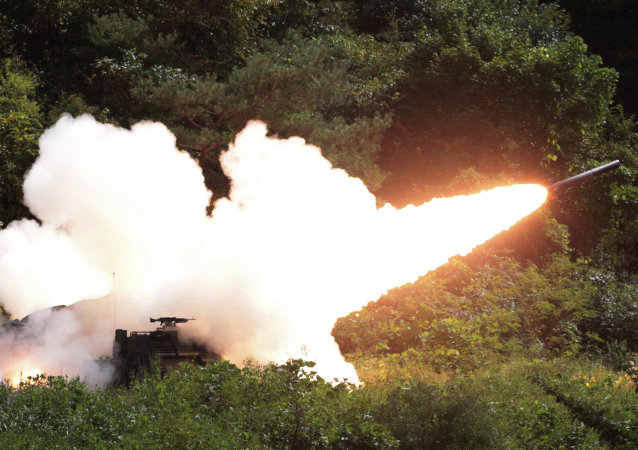 A rocket is fired from a US Multiple Launch Rocket System vehicle during an US military exercise near the demilitarized zone (DMZ) that separates the two Koreas since the Korean War, in Cheorwon, South Korea.