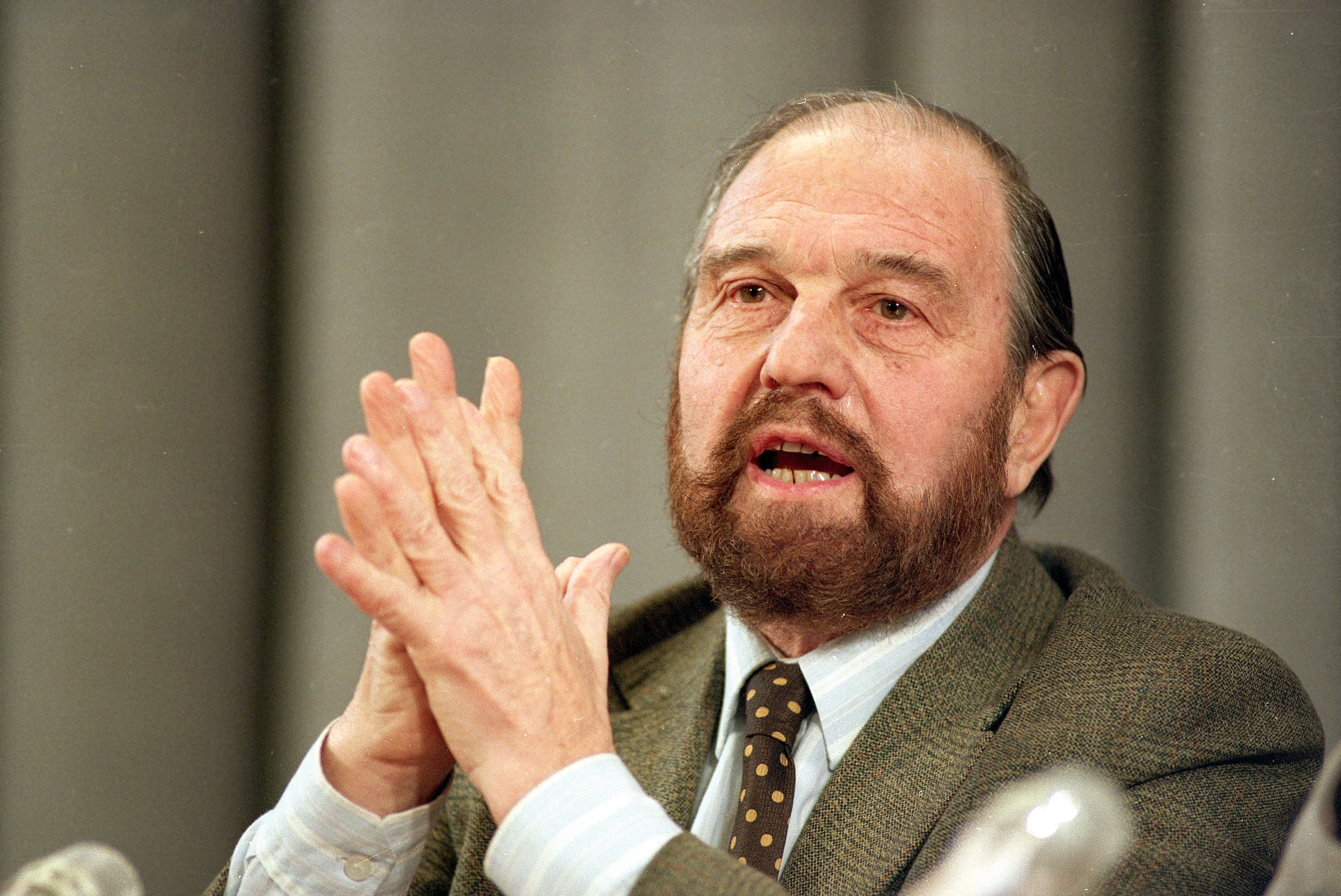 George Blake, a British defector who spied for the Soviets in Britain, gestures during a news conference in Moscow, Jan. 15, 1992