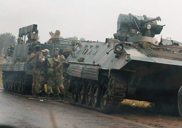 Soldiers stand beside military vehicles just outside Harare, Zimbabwe