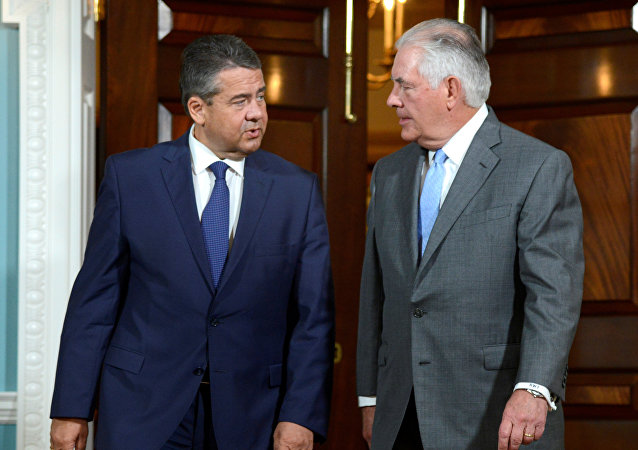 U.S. Secretary of State Rex Tillerson (R) and German Foreign Minister Sigmar Gabriel walk out to meet the press where Tillerson made a statement about the flooding in Houston, Texas, but declined questions, prior to a bilateral meeting, at the State Department, in Washington, U.S., August 29, 2017
