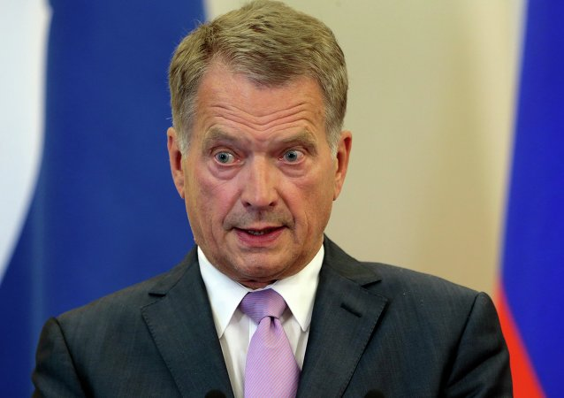 Finnish President Sauli Niinisto speaks during his and Russian President Vladimir Putin's news conference after the talks at a residence at the Black Sea resort of Sochi, southern Russia, in Sochi, Russia, Friday, Aug. 15, 2014