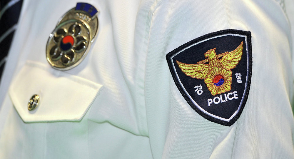 A logo of South Korean National Police Agency is seen on an arm of a policeman during a ceremony at a gymnasium in Seoul on February 15, 2012