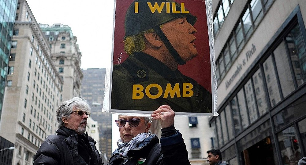 Anti-war protesters shout slogans against US President Donald Trump during a demonstration in front of the Trump Tower in New York on April 7, 2017, to protest the US air strike in Syria